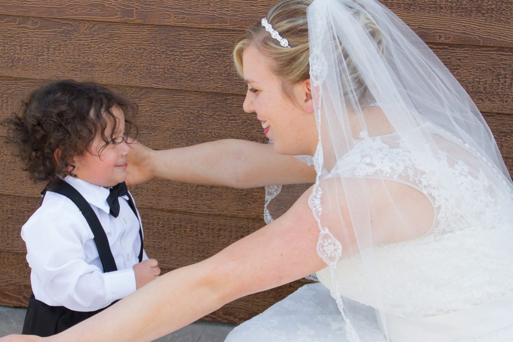 Bride Hugs Adorable Ring Bearer