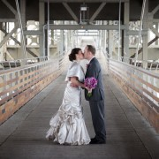 Bride and Groom Kiss Under A Milwaukee Bridge