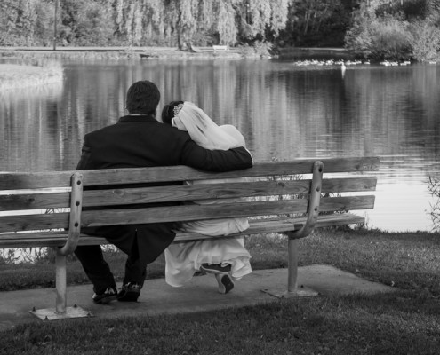 Bride and Groom on Park Bench