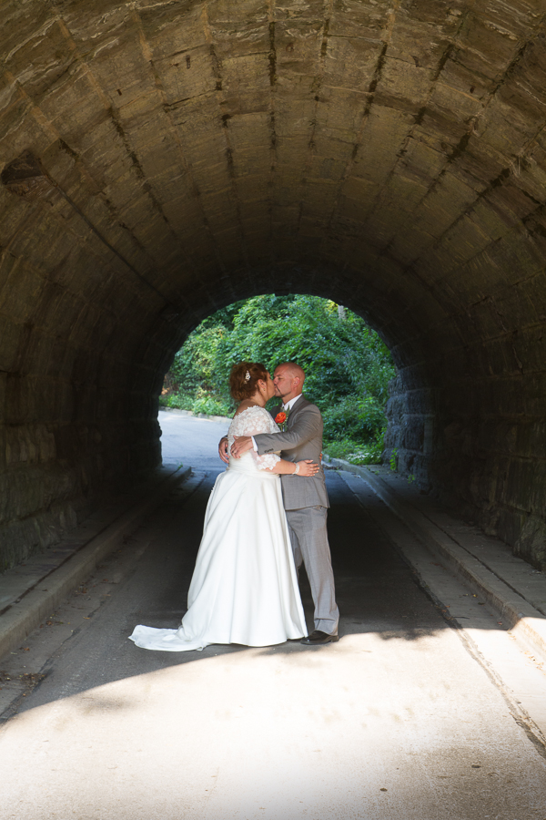 Bride and Groom under tunnel